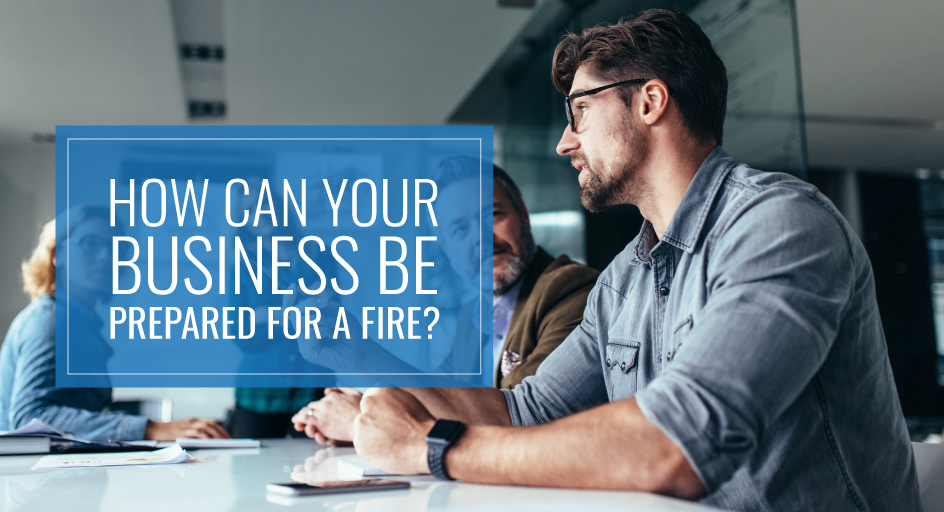 blog image of business professionals discussing fire prevention plans